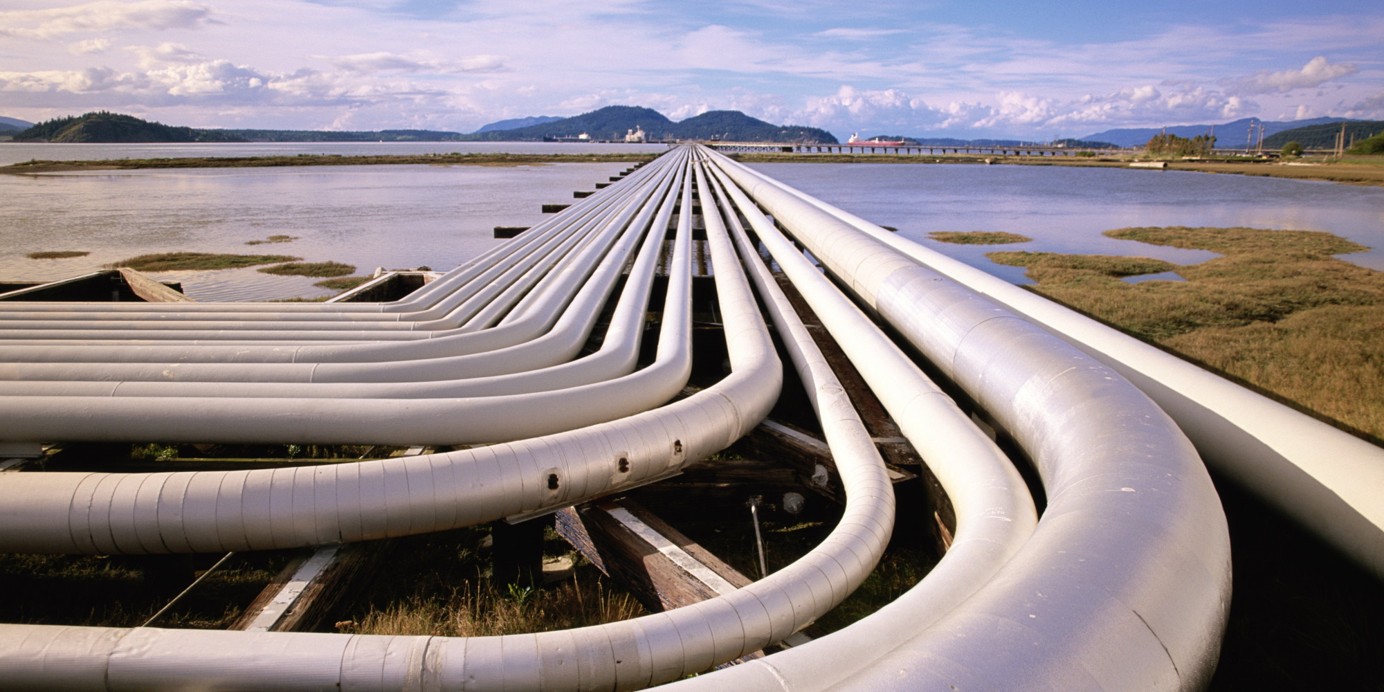 PETROLEUM PIPES AND OIL TANKER AT PIER